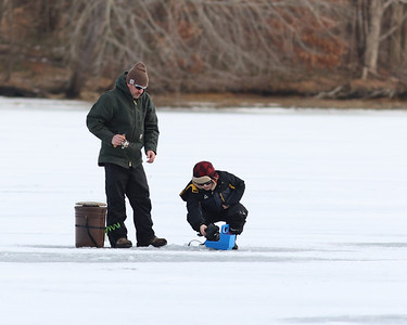 Jason Azzarello and his son Dean,8, fish on Moraine State Park's Lake Arthur Saturday. Dozens of anglers took to the lake to take advantage of one of the first days in over a year with enough ice to fish on. Seb Foltz/Butler Eagle 01/30/21