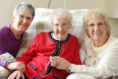 Sisters, Abbie Reader (left) and Karen Twilliger pose for a photograph with their mother Veda McGinnis, who turned 107 years old on January 31, 2021. Harold Aughton/Butler Eagle.