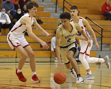 Butler's Devin Carney drives down the court against North Hills Saturday. Butler held on in the closing seconds for a road win. Seb Foltz/Butler Eagle 02/13/21