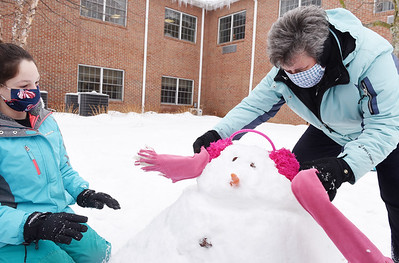 Seventh grader, Amelia Turner and fourth grade teacher, Kelly Carney and of St. Luke Lutheran School, help make a snowman at the Concordia Lutheran Ministries Campus in Cabot Thursday, February 18, 2021. Harold Aughton/Butler Eagle