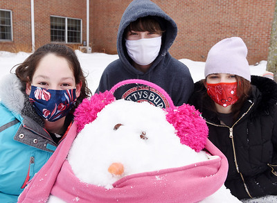 Seventh graders, (from left) Amelia Turner, Ashlee Reith, and Ila Brinckle of St. Luke Lutheran School show off their snowman they built at the Concordia Lutheran Ministries campus in Cabot Thursday, February 18, 2021. Harold Aughton/Butler Eagle.