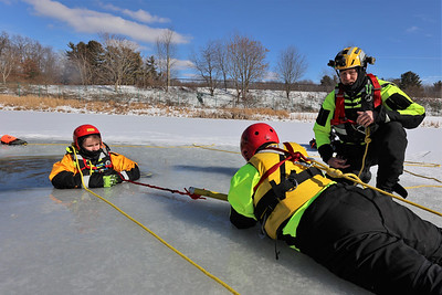 Butler Community College parks and recreation management professor Chris Calhoun  instructs students Ross Moser (left) and Ellie Robinson during ice rescue training  at the college's fire training center. Seb Foltz/Butler Eagle 02/17/20