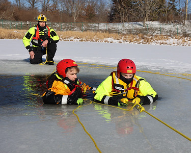 Butler Community College parks and recreation management professor Chris Calhoun watches students Ross Moser (left) and Ellie Robinson practice ice rescue techniques at the college's fire training center. Seb Foltz/Butler Eagle 02/17/20