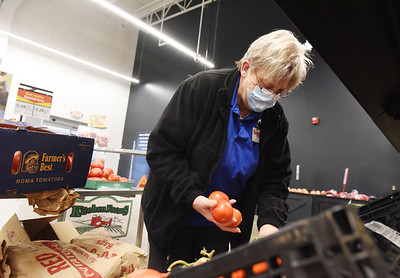 Sue Bartholomew, assistant manager of the Save A Lot store in New Castle, spent Friday morning restocking the produce section of the Butler store. Friday, February 19, 2021. Harold Aughton/Butler Eagle