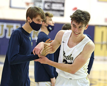 Butler's David Leslie celebrates scoring a career high 22 points with teammate C.J. Singleton on senior night earlier this month. Seb Foltz/Butler Eagle   (Feb. 2021)
