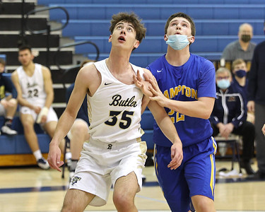 Butler's David Leslie challenges a defender for a rebound on senior night earlier this month. Leslie scored a career high 22 pointsin the home win. Seb Foltz/Butler Eagle   (Feb. 2021)