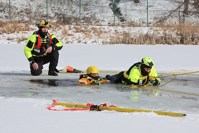 Butler Community College parks and recreation management professor Chris Calhoun watches students Trey Barto and and Kyra Costar practice ice rescue techniques at the college's fire training center. Seb Foltz/Butler Eagle 02/17/20