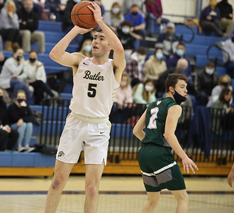 Butler's Mattix Clement takes a shot to reach 1,000 career points Saturday. (Butler overtime win at home against Pine Richland). Seb Foltz/Butler Eagle 02/20/21