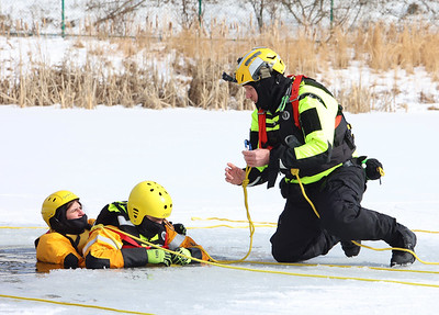 Butler Community College parks and recreation management professor Chris Calhoun  instructs students during ice rescue training  at the college's fire training center. Seb Foltz/Butler Eagle 02/17/20