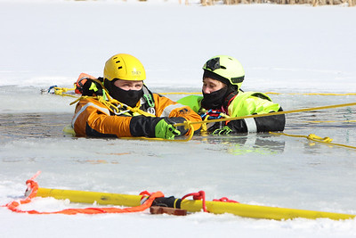 Butler County Community College parks and recreation management students Trey Barto and Kyra Costar practice ice rescue techniques at the college's fire training center Wednesday. Seb Foltz/Butler Eagle 02/17/20