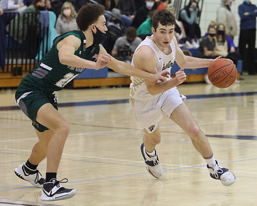 Butler's Mattix Clement drives down the court against Pine Richland's Dylan Serafini in Butler's overtime home win Saturday. Clement scored his 1,000th career point in the game. Seb Foltz/Butler Eagle 02/20/21