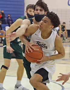Butler's Devin Carney drives to the hoop against Pine Richland's Jameson O'Toole in Saturday's overtime home win. Seb Foltz/Butler Eagle 02/20/21