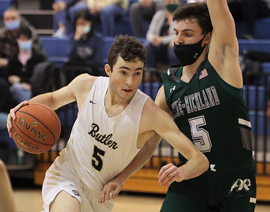 Butler's Mattix Clement drives to the hoop against Pine Richland's Joe Petcash. Clement reached the 1,000 point mark in the overtime win. Seb Foltz/Butler Eagle 02/20/21