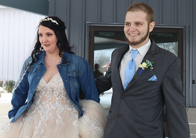 Knoch High School sweethearts Cody Johnston,24, and Sarah Burkhart, 26,  tied the knot at New Life Church outside of Saxonburg Saturday. The couple had been planning a summer wedding but had to move up the ceremony for Feb. 20 in light of health concerns for Johnston. He has been battling cancer and was given a dire prognosis. The Butler Eagle covered their story earlier this month. Seb Foltz/Butler Eagle 02/20/21
