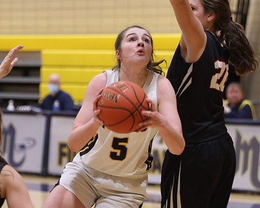 Mars' Ava Black drives to the hoop against Indiana's Katie Kovalchick Tuesday at home. Seb Foltz/Butler Eagle 02/23/21