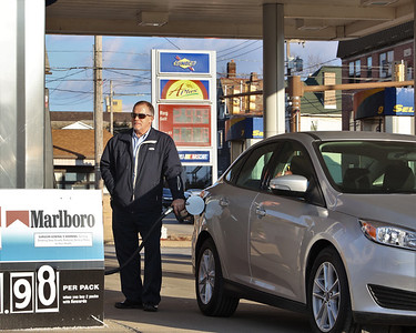 Gino Sabruno of Butler fills up his gas tank at the Sunoco on West Jefferson Street Tuesday. Seb Foltz/Butler Eagle 02/23/21