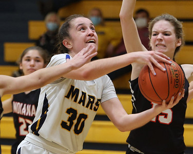 Mars' Olivia Donnelly drives to the hope and draws a foul against Indiana's Abbie Huey Tuesday. Seb Foltz/Butler Eagle 02/23/21