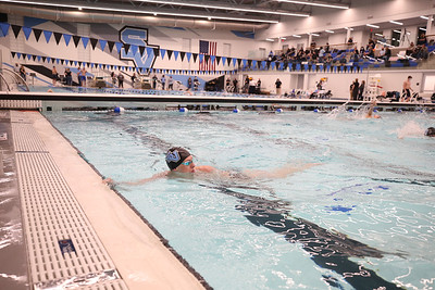 A Seneca Valley swimmer warms up in the school district's new pool during the venue's inaugural event Thursday. Seb Foltz/Butler Eagle 02/19/21