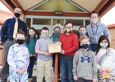 Third-grade class of Mr. Adam Mercer at Northwest Elementary raised money for the family of Tristan Oesterling, the 2-yr-old who died in the New Years Eve fire on Knox Ave. (From left) first row: Stevie Lesney, Luke Macko, Josh Fink, Cooper Stevenson, and Kiarra Stanford. Second row: Principal Matt Martinez, Averie Henzler, Vayda Byers, Cullen Hutchison, and third-grade teacher, Mr. Adam Mercer at Northwest Elementary. Tuesday, February 23, 2021. Harold Aughton/Butler Eagle.