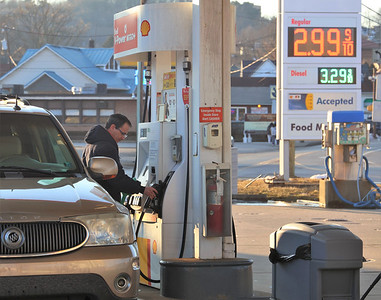 Jesse Gaiser of Butler replaces the gas pump handle after filling up at the Shell station on at West Cunningham and West Jefferson Streets Tuesday. Seb Foltz/Butler Eagle 02/23/21
