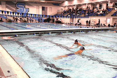 Seneca Valley swimmers warmup in the school district's new pool during the venue's inaugural event Thursday. Seb Foltz/Butler Eagle 02/19/21