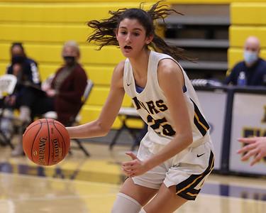 Mars' Kaitlyn Pelaia brings the ball down the court at home against Indiana Tuesday. Seb Foltz/Butler Eagle 02/23/21