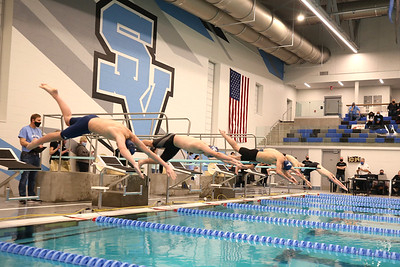 Seneca Valley and Butler swim team members dive in the new Seneca Valley School District pool during the venue's inaugural event Thursday. Seb Foltz/Butler Eagle 02/19/21