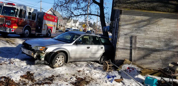 Jim Smith photo. A sport utility vehicle ended up against a house on Main Street in West Sunbury just before 8 a.m. Wednesday when the driver lost control on the ice-covered road. The driver, a 60-year-old woman, was not injured and there was no one in the house.  State police and firefighters said icy road conditions was a factor in the accident.