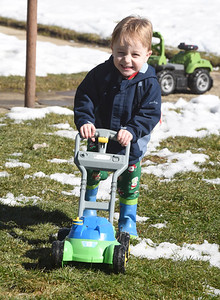 Three-year-old Shannon Bradley of Mars broke out his lawn mower Wednesday, February 24, 2021. Harold Aughton/Butler Eagle.