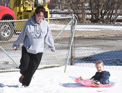 Babysitter Amanda Lytle of Mars, pulls 3-year-old Shannon Bradley through the snow Wednesday, February 24, 2021. Harold Aughton/Butler Eagle.