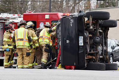 Firefighters extract the drive of a Dodge Ram following a 3 vehicle traffic accident at the intersections of Route 8 and Vogel road Wednesday, February 24, 2021. Harold Aughton/Butler Eagle.