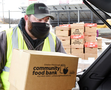 Nick Glasser of Butler took a day off of work to volunteer handing out food at the Greater Pittsburgh Community Foodbank food distribution at Lernerville Speedway, Tuesday, February 23, 2021. Harold Aughton/Butler Eagle.