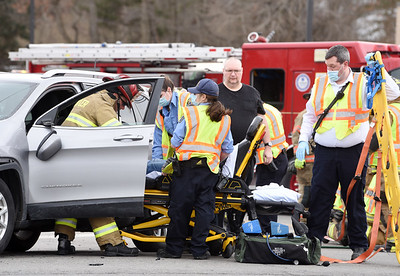 First responders remove a woman from a Jeep Cherokee following a 3-vehicle accident at the intersection of Route 8 and Vogel roads Wednesday, February 24, 2021. Harold Aughton/Butler Eagle.