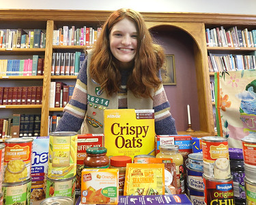 Girl Scout Rachel Blose with a sample of the contents of one of the food bags she organized for those in need. Seb Foltz/Butler Eagle