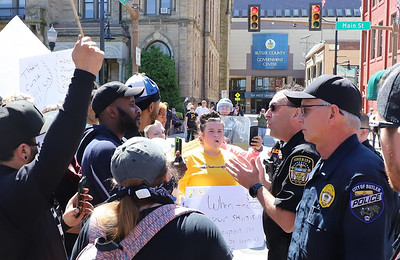 Butler Sheriff Mike Slupe talks to a protester last Sunday at the protest in downtown Butler. Seb Foltz/Butler Eagle  05/31/20