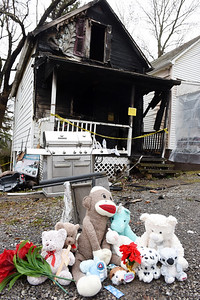 Friends, and neighbors made a make-shift memorial in memory of Tristan Oesterling, 2, who died New Year's Eve after his family's home caught on fire on Knox Avenue in Butler. Harold Aughton/Butler Eagle.