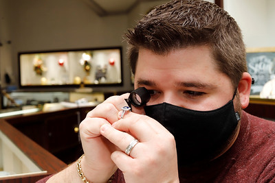 Spencer Mathew of Mathew Jewelers inspects a sapphire gemstone on a ring. Seb Foltz/Butler Eagle 12/29/20