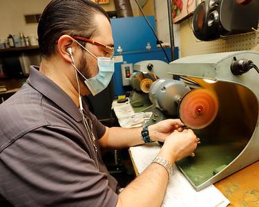 Greg Eichhorn of Mathew Jewelers polishes a ring. Seb Foltz/Butler Eagle 12/29/20