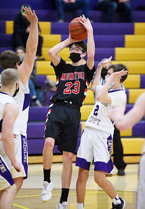 Moniteau's Kyle Pry (#23) attempts a shot in front of Karns City's Taite Beighley (#2) Friday, January 8, 2021. Harold Aughton/Butler Eagle.