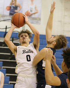 Butler guard Raine Gratzmiller goes up for a shot over Kiski's Aiden Wohl in Friday's 78-58 home win. The game was Butler's first since the December sports shut down, and moves them to 2-0 on the year. Seb Foltz/Butler Eagle 01/05/20