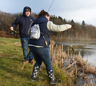 Joe Dubois of Prospect watches as his wife, Sierra Dubois pulls in a small mouth bass from Glade Run Friday afternoon, January 8, 2020. Harold Aughton/Butler Eagle.