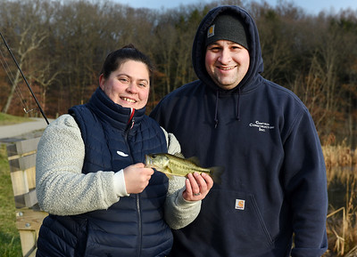 Newlyweds Sierra and Joe Dubois of Prospect fish along the banks of Glade Run Friday afternoon, January 8, 2021. Harold Aughton/Butler Eagle.