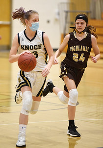 Knoch's Maddie Boyer #33 pushes the ball down the court in front of Highland's Jocelyn Bielak #24 in the third period Monday, January 11, 2021. Harold Aughton/Butler Eagle.