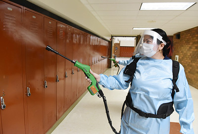 Custodian Viamarie Irigoyen used an electrostatic sprayer to disinfect the lockers at the Butler Intermediate High School Tuesday, January 12, 2021. Harold Aughton/Butler Eagle.