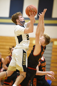 Knoch's Ryan Lang, #20, goes up for a layup against North Catholic's Tommy Molenda, #21, Tuesday, January 12, 2021. Harold Aughton/Butler Eagle.