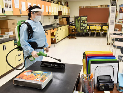 Custodian Viamarie Irigoyen used an electrostatic sprayer to disinfect the classrooms at the Butler Intermediate High School Tuesday, January 12, 2021. Harold Aughton/Butler Eagle.