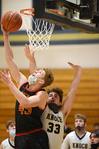 North Catholic's #45, attempts a reverse layup against Knoch's Z. McMillen Tuesday, January 12, 2021.  Harold Aughton/Butler Eagle.