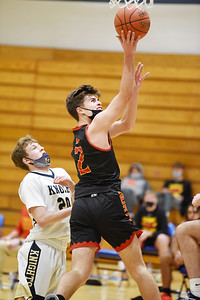 North Catholic's L. King, #2, goes up for a layup in front of Knoch's Ryan Lang, #20. Harold Aughton/ Butler Eagle.