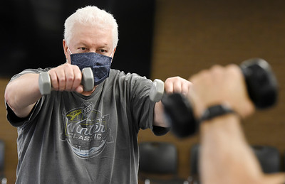 Dave Steighner, 64, of Meridian has had Parkinson for the past three years works out with YMCA trainer Lou Yossa, 77, during the Exercise for Parkinson class Monday, January 4, 2021. Harold Aughton/Butler Eagle