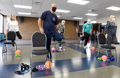 From left, Sue Christy, Steven Appel, Regis Rice, Dave Steighner and Sharon Appel take part in the Exercise for Parkinson class at the Butler YMCA, Monday, January 11, 2021. Harold Aughton/Butler Eagle.